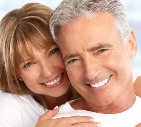 image of male and female smiling, elated that their teeth are covered by the best Dental Insurance plan in Franklin, TN