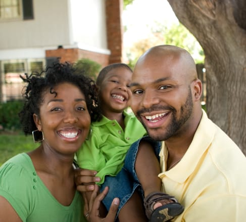 image of a family buying the best affordable life insurance they can in Franklin TN while carrying their child